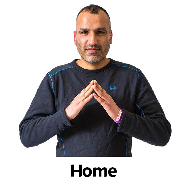 man saying home in british sign language