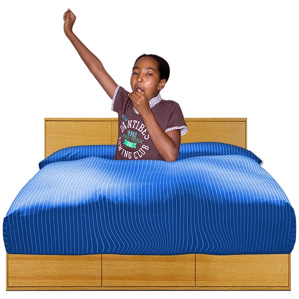 young person yawning in bed