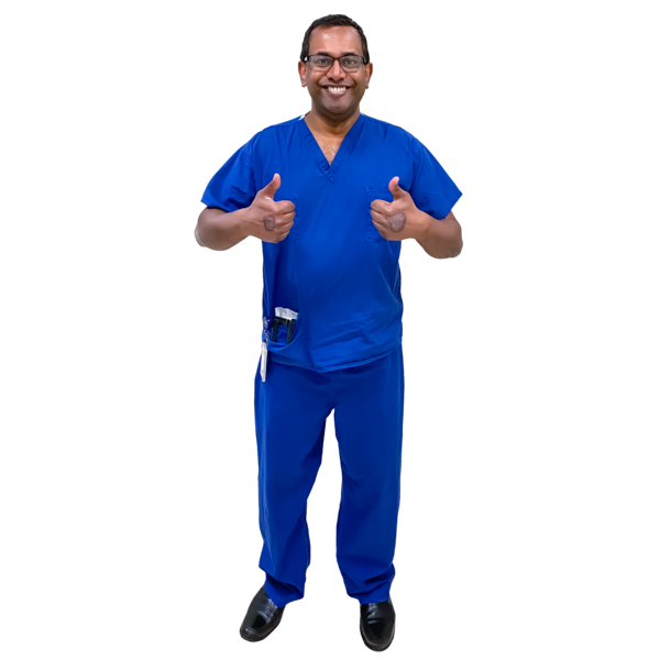doctor in blue giving two thumbs up