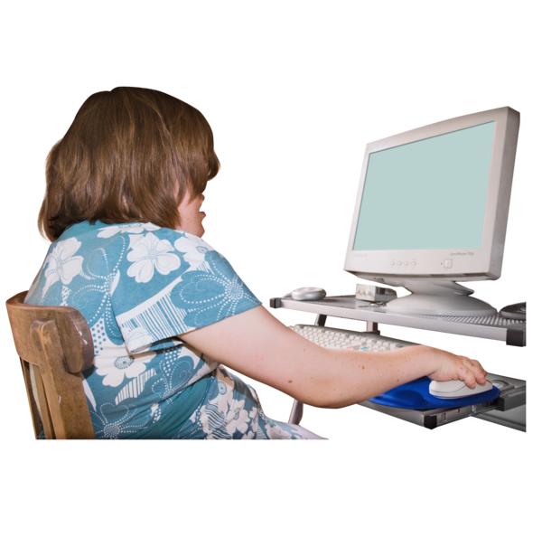 a teenage girl sitting at a computer